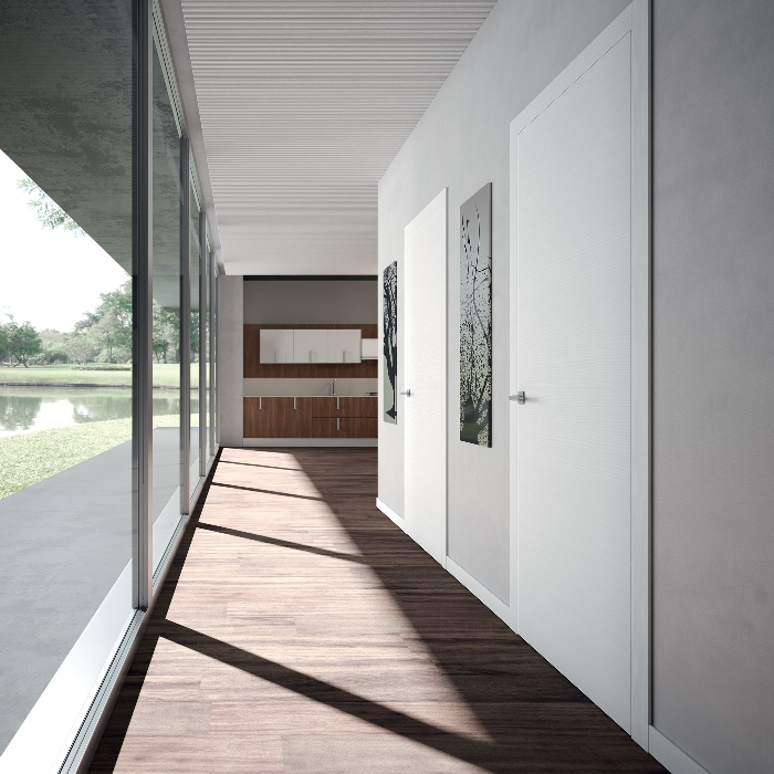 Porte interne in laminato o in essenze naturali nuova ocim - Porte filo muro ...
